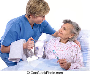 nurse with a senior woman - Nurse helps the senior woman in...