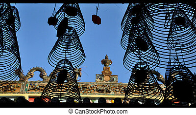 Silhouette of hanging incense coils