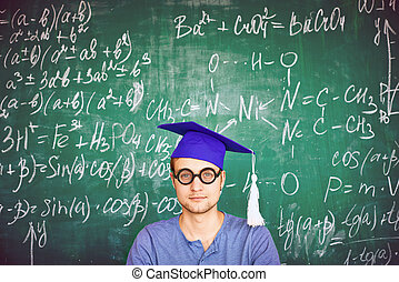 Graduation student - Portrait of handsome student in...