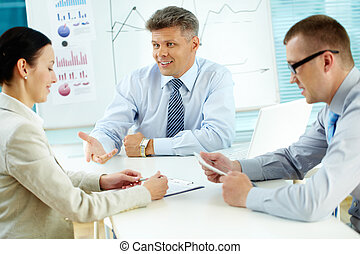 Business discussion - Business team brainstorming while...