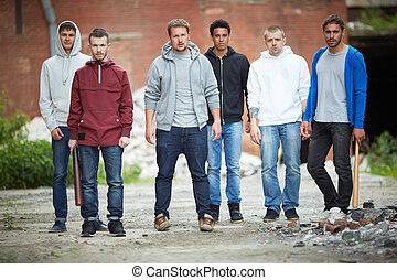 Dangerous guys - Portrait of spiteful guys on the street