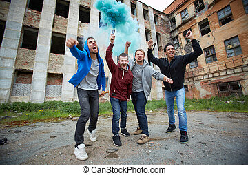 Explosion in ghetto - Portrait of dangerous guys shouting in...