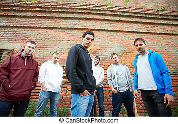 Street gang - Portrait of several street hooligans or...