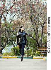 Young beautiful woman in the autumn park