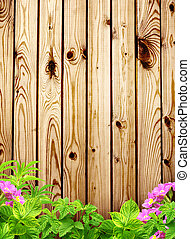 Summer background with old wooden fence, flower and green...