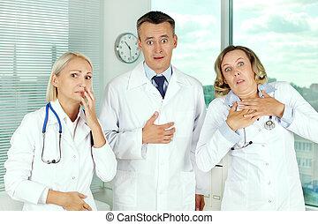 Oops - Three unpleasantly surprised clinicians in white...