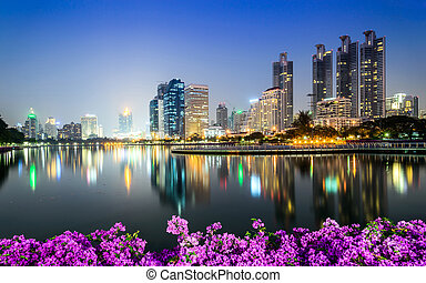Bangkok city downtown at night with Bougainvillea flower...