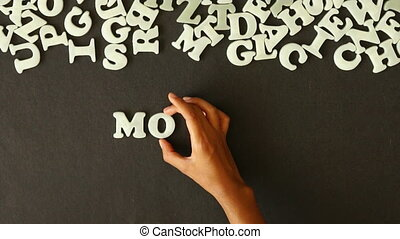 Monday (In German) - A person spelling Monday with Plastic...