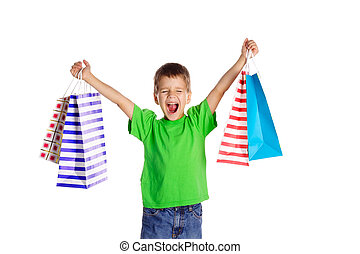 Happy boy with shopping bags, isolated on white