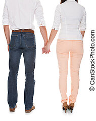 Portrait Of Young Couple Holding Hands - Young Couple...