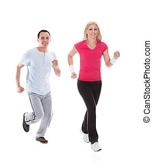 Fitness couple running towards camera. Isolated on white