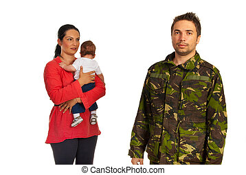 Mother with baby come to military father in front of image...