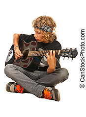 Teen boy playing acoustic guitar isolated on white...