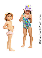 Sisters in swimsuit using sunscreen cream - Two sisters in...