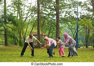 Muslim family having fun at outdoor