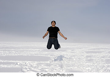 Man jumping into the air in the winter season