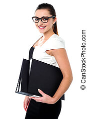 Young business professional posing with folders