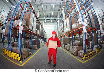 worker with box - worker in red uniform with box in the...