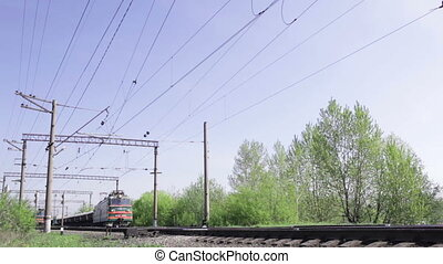 Freight train. Morning, sunny. - Freight train shot from low...
