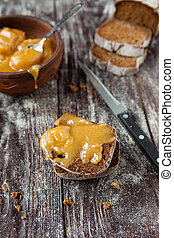 bread and honey on a wooden table, food
