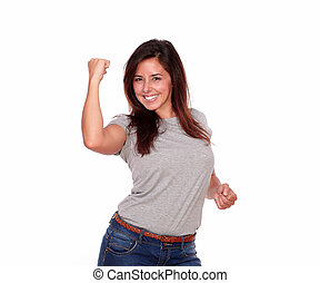 Happy smiling young woman celebrating a victory