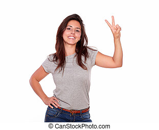 Smiling woman showing victory sign with fingers