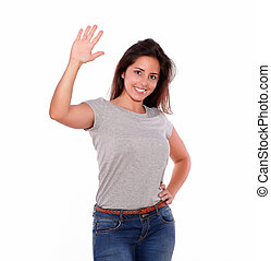 Charming young woman greeting with her hand