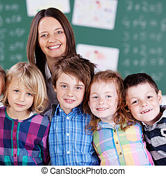 Happy teacher and students - Portrait of happy teacher in...