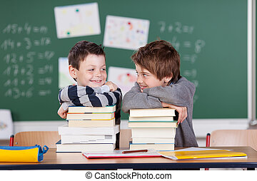 Two friends - Two male friends studying with a pile of books...