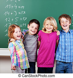 Laughing children - Portrait of laughing schoolchildren in...