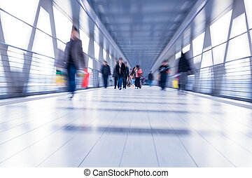 Passenger in the Beijing bus station.Motion blur