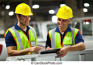 shipping company workers - two shipping company workers...