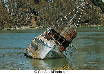 boat sinking in the water - a fishing boat abandon and...