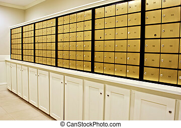 mailboxes - rows of indoor brass mailboxes above locked...