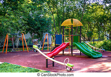 Children playground in the yard in summer