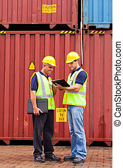 inspectors standing next to containers