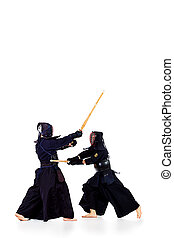 asian martial - Two kendo fighters are fighting with each...