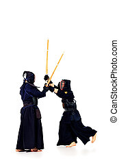 kendo fighters - Two kendo fighters are fighting with each...