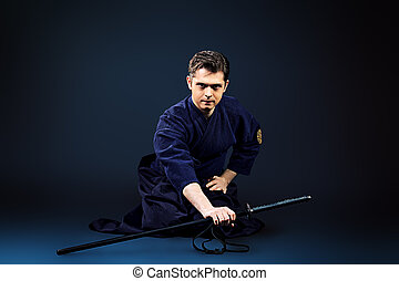 practicing kendo - Handsome young man practicing kendo Over...