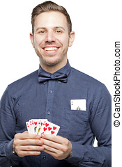 Hipster man in bow tie looking stylish playing poker holding...