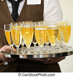 Waiter carrying a tray of champagne - Closeup view of the...