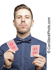 Hipster man in bow tie looking stylish playing poker