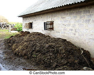 heap of the dung besides the shed - image of heap of the...