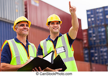 inspectors doing inspection at the container yard - two...