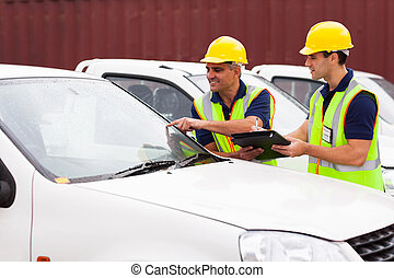 shipping company worker inspecting cars - shipping company...