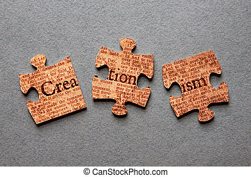 Creationism Jigsaw Mismatched - The word Creationism against...
