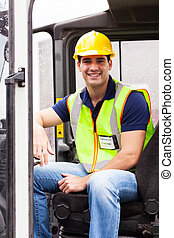 young forklift driver - portrait of smiling young forklift...
