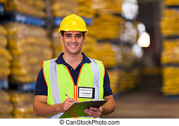 young warehouse worker - portrait of young warehouse worker...