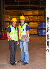 shipping and warehouse workers - two shipping and warehouse...