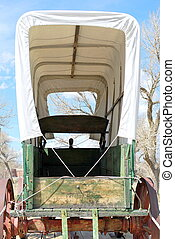 Covered wagon. - Covered wagon on display outdoors.